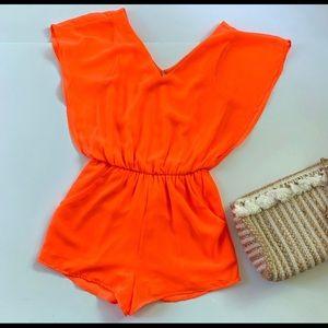Gianni Bini Neon Orange Romper with Pockets.